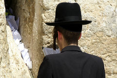 Hasidic jews by wailing wall. Hasidic jews at the wailing western wall, jerusalem, israel Royalty Free Stock Images