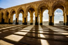 Shadows and arches with cloudy sky in background royalty free stock photos