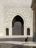 Hassan II Mosque Gate. Person praying in one of the doors of the Mosque of Hassan II Royalty Free Stock Image