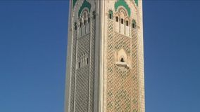 Hassan Mosque hand held shot panning down tower stock video footage