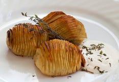 Hasselback Swedish potatoes Stock Image