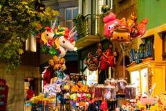 HASSELT, BELGIUM - AUGUST 8 2018: Products in souvenir boutique. In indoor theme park Plopsa in Hasselt Belgium royalty free stock photos
