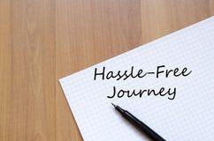 Hassle free旅途在笔记本写 库存图片