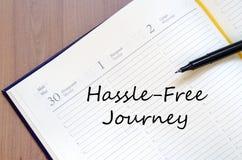 Hassle free旅途在笔记本写 免版税库存照片