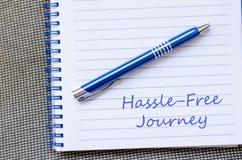 Hassle free旅途在笔记本写 库存照片