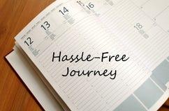 Hassle free旅途在笔记本写 免版税库存图片