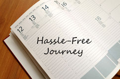Hassle free journey write on notebook. Hassle free journey text concept write on notebook Royalty Free Stock Image