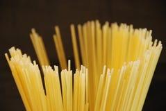 Hasta la pasta. Pasta spaghetti round in the dark Stock Photos