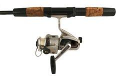Haste e carretel isolados velhos de pesca Foto de Stock