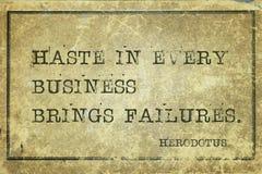 Haste Herodotus. Haste in every business brings failures - ancient Greek historian Herodotus quote printed on grunge vintage cardboard stock photography