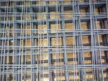 A haste reforçada de aço para o concreto na construção, aço da rede de arame para a construção pôs uma pilha imagens de stock