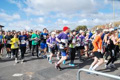 Hastings Half Marathon, 2014. Runners take part in the 30th annual Hastings Half Marathon race at Hastings in East Sussex, England on March 23, 2014 stock photography