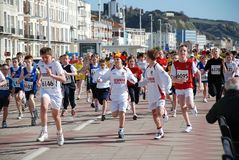 Hastings Mini Run. Young people taking part in the annual Mini Run held in conjunction with the Hastings Half Marathon race along the seafront at Hastings in Stock Photo