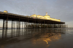 Hastings Pier. In the last rays of sunlight. East Sussex, UK royalty free stock photo