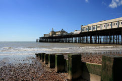 Hastings Pier with groynes, East Sussex, Royalty Free Stock Image
