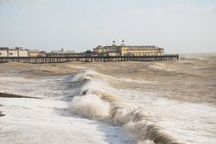 Hastings pier in stormy sea Royalty Free Stock Photo