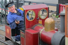 HASTINGS, UK - JULY 23, 2017: Close-up on the driver of a steam train at the Hastings Miniature Railway located at Rock-a-Nore Roa Stock Photos