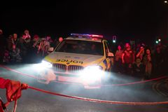 Hastings UK, 10/13/18 - Police car in the middle of the crowd stock photography