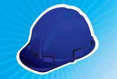 Hat. A blue colour hard hat in blue radiant light Royalty Free Stock Photo