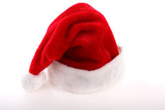 Hat. Red santa hat on white background Royalty Free Stock Photography