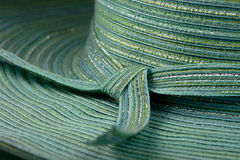 Hat. Close-up of teal and silver colored hatband of women's stylish summer hat royalty free stock photos