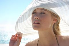 Hat. Portrait of a woman with an hat in summertime Royalty Free Stock Photos