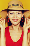 In hat against yellow Stock Photography