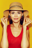 In hat against yellow Royalty Free Stock Image