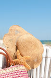 Hat and bag at beach Stock Photo