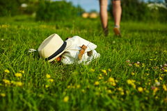 Hat and bag lying in the park Stock Photo