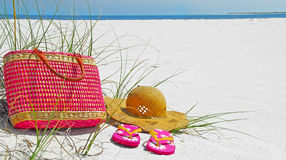Hat, bag, and sandals on beach Royalty Free Stock Photos