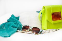 Hat, bag, scarf, sunglasses isolated on a white background. Nice colored accessories Stock Photos