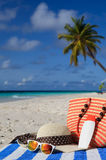 Hat, bag, sun glasses on tropical beach Royalty Free Stock Image