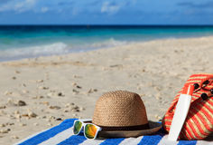 Hat, bag, sun glasses on tropical beach Royalty Free Stock Images