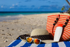 Hat, bag, sun glasses on tropical beach Royalty Free Stock Photography
