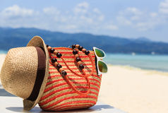 Hat, bag and sun glasses on tropical beach Stock Image