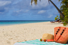 Hat, bag, sun glasses on tropical beach Royalty Free Stock Photo