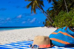 Hat, bag, sun glasses on a tropical beach Stock Photo