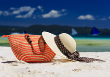 Hat and bag on tropical beach Royalty Free Stock Image