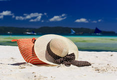 Hat and bag on tropical beach Stock Image