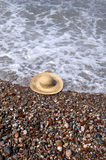 Hat at the beach Stock Images