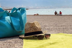 Hat, beach bag and the glasses on the rug Royalty Free Stock Images