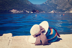 Hat and beach bag near the sea in Montenegro Stock Image