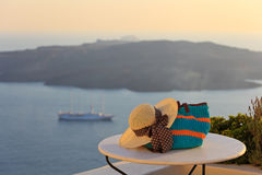 Hat and beach bag in Santorini island Royalty Free Stock Photography