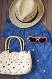 Hat, beach bag and sunglasses on  wooden background Stock Photos