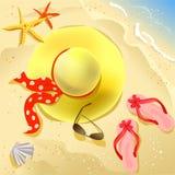 Hat on the beach Stock Photos