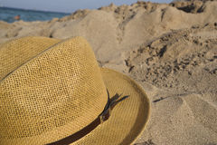 Hat on the beach. Thatched hat on a sand beach Stock Photo