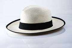 Hat and black ribbon. On a white background royalty free stock photo