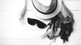 Hat and blue scarf with sunglasses black and white color Stock Photos