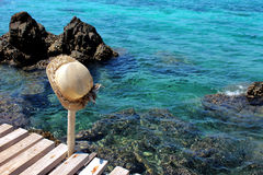 Hat with blue sea, rock and wood pier. In Thailand Royalty Free Stock Image